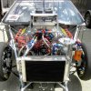 Picture of an 822 Cubic Inch engine in a Ford Cobra Jet drapsgter car.